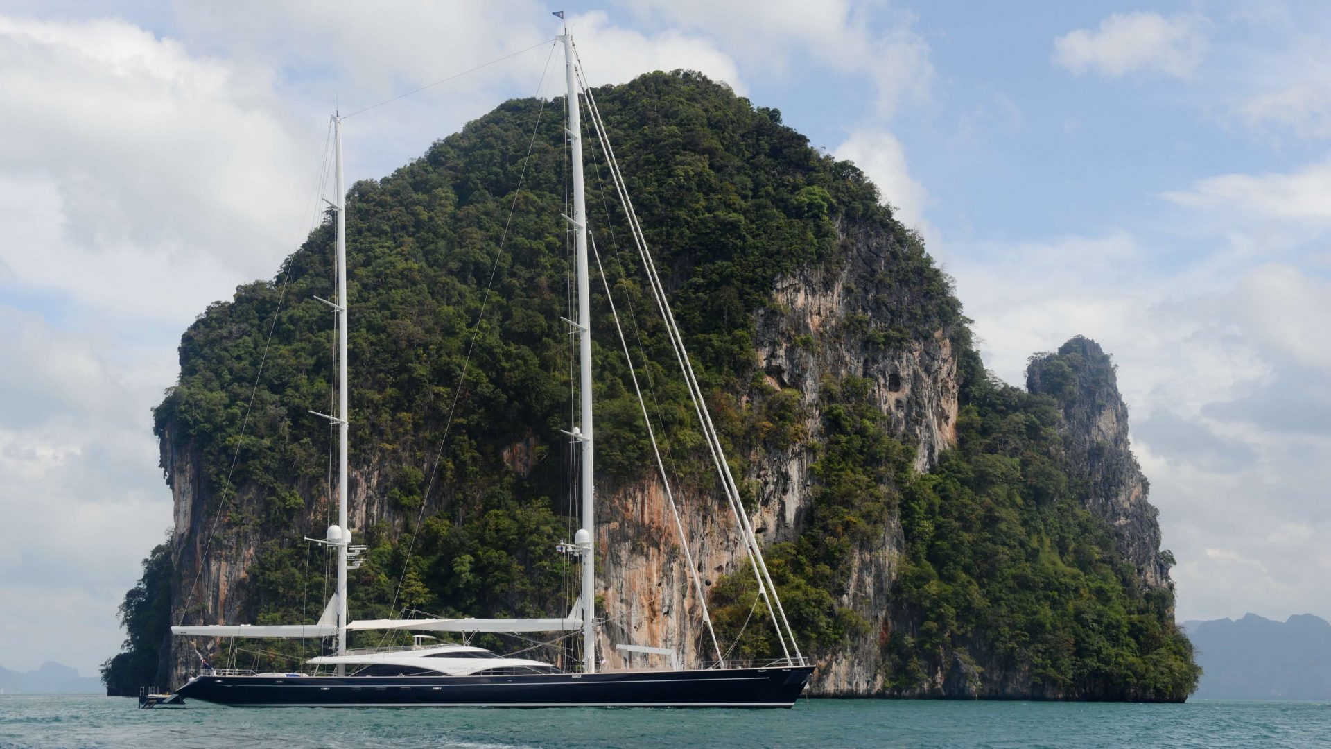 Royal Huisman - photo by owner TWIZZLE at anchor in front of limestone rock Asia c